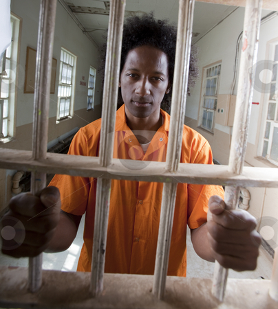 cutcaster-photo-100701930-Young-African-American-Man-Behind-Bars